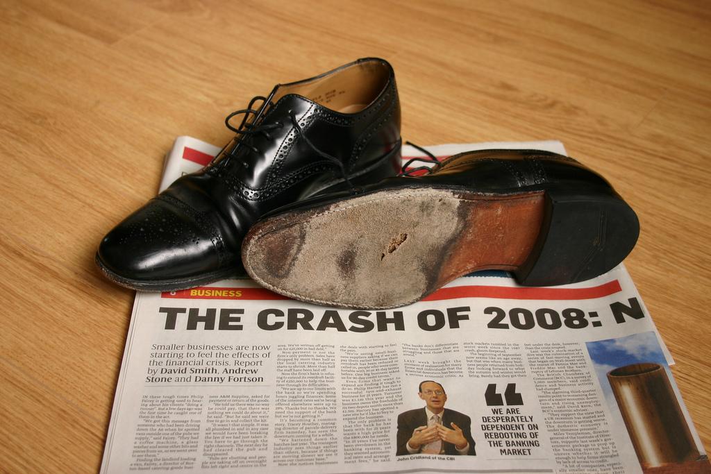 Money Economy 2008 Crash Headline Shoes Sole Hole
