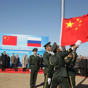 Chinese Soldiers Raise Russian Flag
