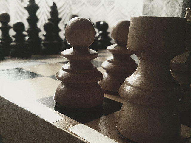 Gold Investing Precious Metals IRA Closeup Chess Board