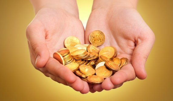 Precious Metals IRA Gold Investing Hands Hold Gold Coins