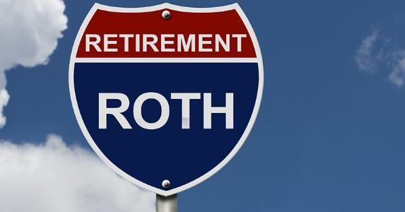 Retirement Roth IRA Rollover Interstate Highway Sign Blue Sky